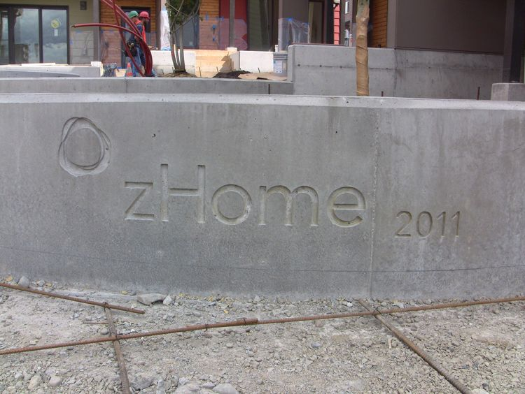 I have a bit of a fetish for concrete inlays. This is our project logo.