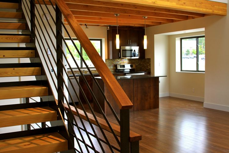 """The layouts are open, simple, beautiful, and modern; we call the style """"modern organic.""""  Pictured is a two bedroom unit; studio and three-bedroom homes are also included in the community."""