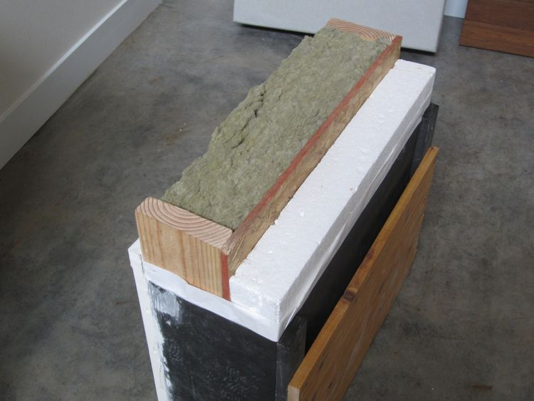 Our R-38 wall section. Rockwool insulation is placed in the 2x6 cavity, and 3.5 inches of continuous expanded polystyrene insulation is screwed to the outside of the oriented strand board shear wall. A benefit to this exterior insulation is that the therm