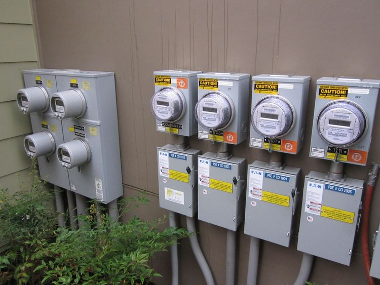 This is a bank of meters for three of the units plus the community system (community loads such as the ground source wellfield are also offset for zero net energy). The meters are the right are production meters. These count every watt of solar energy pro