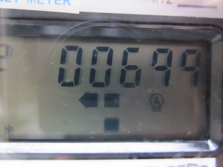 Here's the net meter readout for the Stewardship Center. Even with lights on and computers plugged in, on a cloudy day it is net producing energy, shown by the arrow pointing to the left. At this moment 699 watts are being sent back to the grid.<br /><br