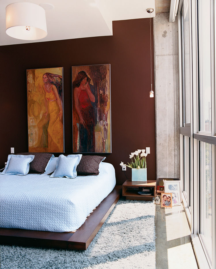 "The bedroom. The addition of the couple's art collection ""has really given [the color] purpose,"" says Julie Gibson."