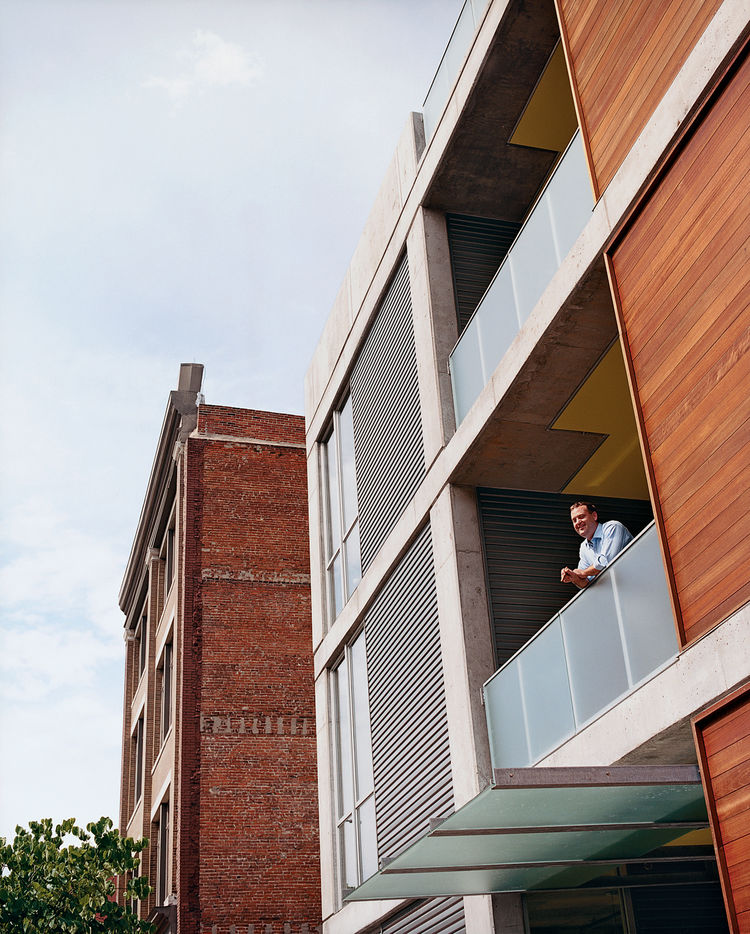 "Developer Chris Sally has been known to have conversations with passersby from his ""cigar-smoking balcony."""