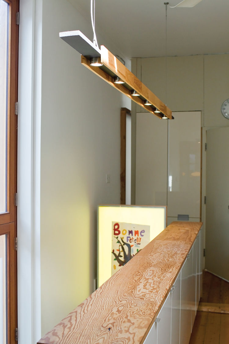 <p><h2>Buddy Hacked It</h2></p> The light fixture hanging over the stairs to the playroom is another Ikea hack: The hanging hardware is actually for curtains, and the six Grundtal lights are meant to be hung under cabinets. They're mounted on a horizontal