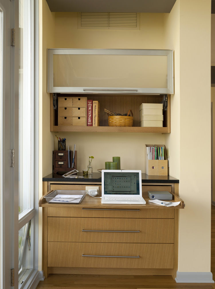 """The workstation, open. """"This was our solution to providing Karen with a place to work at home,"""" says Sundstrom. """"She used to work in the bedroom, but we cut the room down considerably, and we thought it would be best to keep the bedroom as a place to rela"""