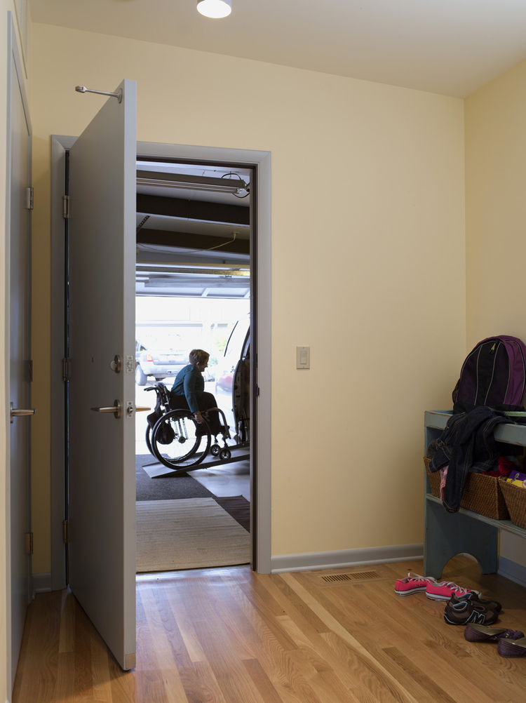 The architects created a mudroom off the garage with plenty of room for quick turnarounds and busy family comings and goings. Much of the garage had been taken up by a large ramp before the concrete floor was repoured on a slope that meets with the house,