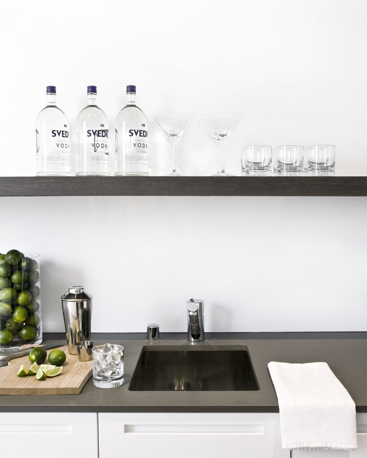 "<p>The wet bar at the end of the kitchen is equipped with a spout for filtered water, ice maker, wine fridge, and over-sink shelving--and is the happy-hour hotspot.</p>Photo by <a href=""http://www.benmayorgaphoto.com"">Ben Mayorga Photography</a>"