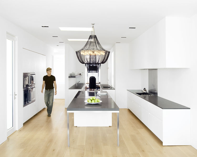 "<p>Hollis designed the kitchen--which features a <a href=""http://www.boffi.com/"">Boffi</a> kitchen system and <a href=""http://www.gaggenau.com"">Gaggenau</a> appliances-- as three zones. The first centers around the stainless-steel-and-Zodiac-stone island,"