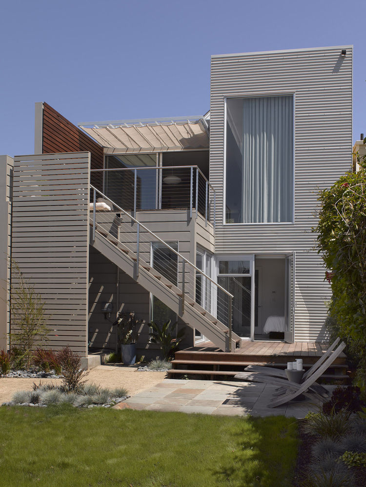 "<p>Willmer completely redesigned and relandscaped the backyard. ""Houses in the early 1900s were built with a strong presence to the street but the back was totally forgotten,"" she says. Now, Willmer admits, the house is almost more oriented towa"