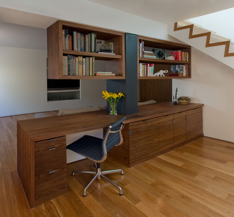 "Because of cost constraints, Franz and Pare-Mayer were unable to alter the existing structure, so they designed built-in furniture and cabinetry to define and differentiate the spaces. They hired Chris Allen, of San Luis Obispo-based <a href=""http://www.c"