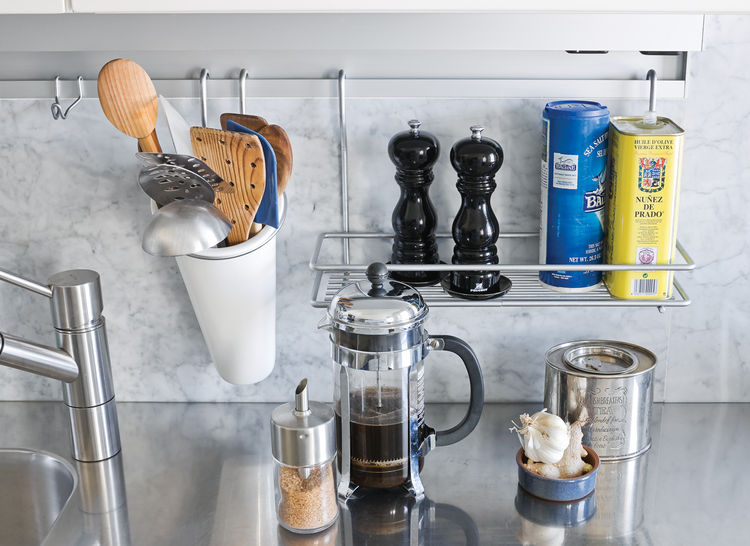 The Abbinks' apartment is a study in details, from the stainless steel kitchen countertop to the clever Arclinea rail system that holds their salt and pepper.