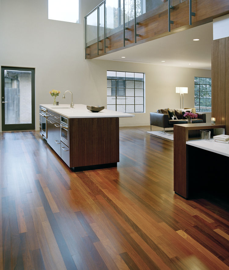 Alter and the residents chose to utilize ipe, an ultra-durable Brazilian hardwood, for the interior flooring and second-story exterior paneling. The wood, so dense that it must be drilled and screwed rather than nailed, often comes in an unpredictable arr