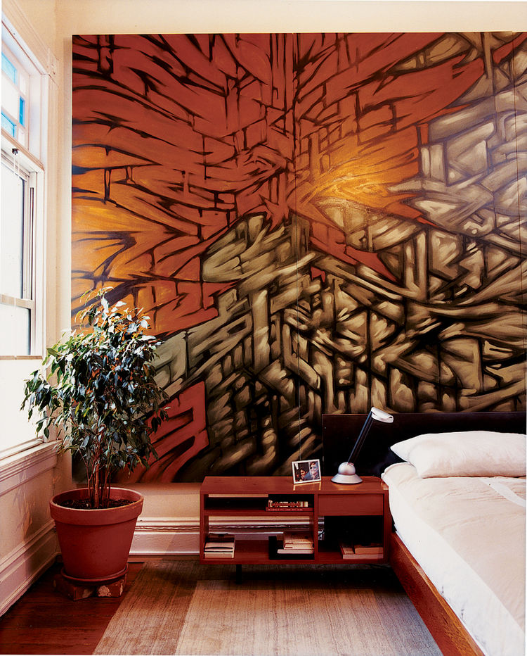Azevedo made the platform bed and side table in her master bedroom, and bartered furniture for the mural by artist friend Mike Stern.