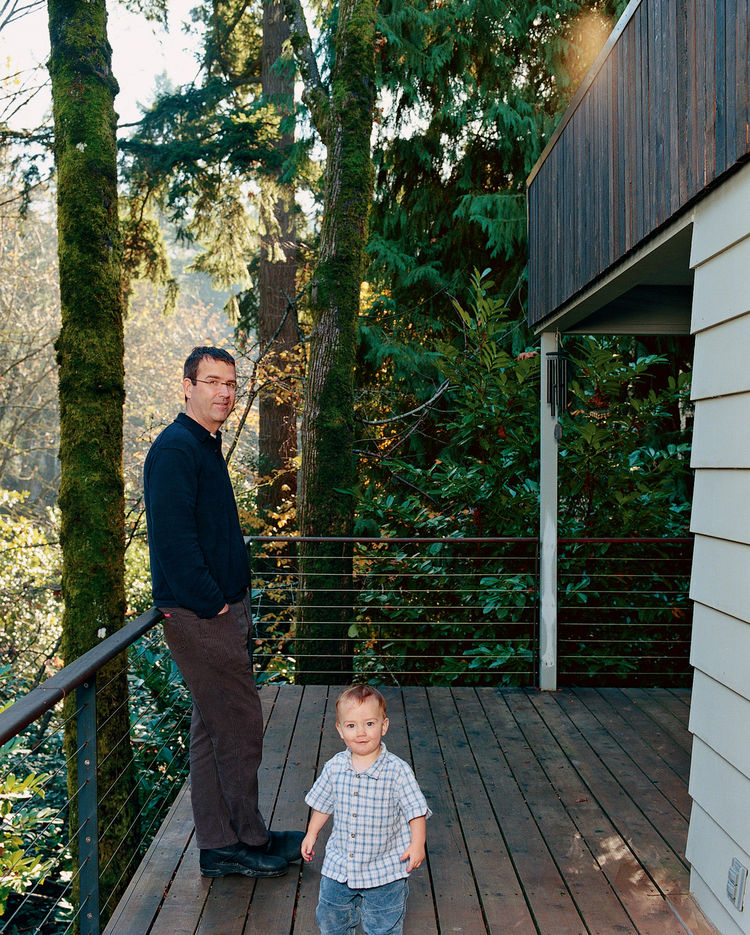 Brian and Markus are pictured here on the ground-floor deck. New stairs lead down to the basement level and garden.