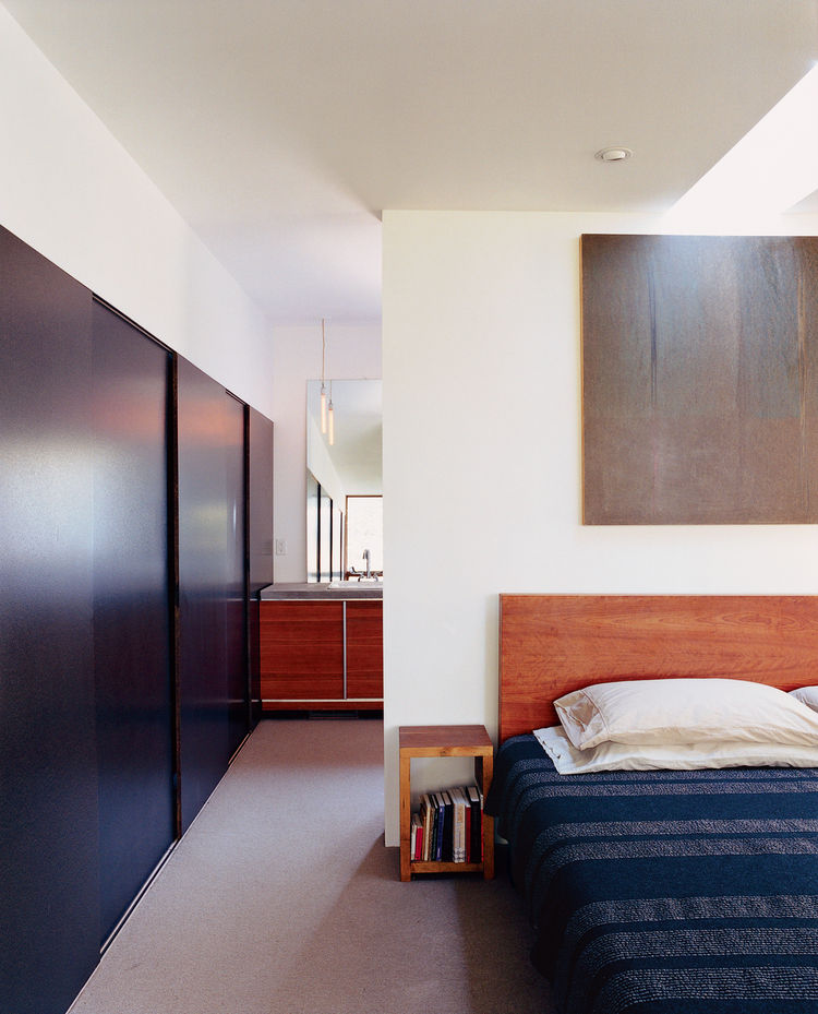 Along one wall of the master bedroom White used Columbia Forest Product's EcoColors panels (an FSC-certified particleboard) to create sliding closet doors.