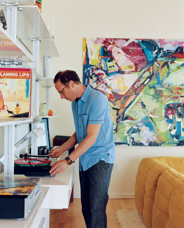 Randy Rapaport can't get enough of his favorite band, the Flaming Lips, and happily whiles away the hours spinning their records in his 1,000-square-foot loft. On the wall is a painting by Timothy Scott Dalbow that Rapaport picked up from the nearby New A