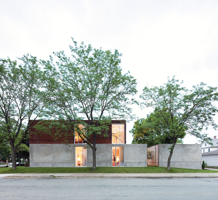 "The home's mix of dark ipe wood, concrete, and glass give credence to Winter's description of it as ""an open bunker."""