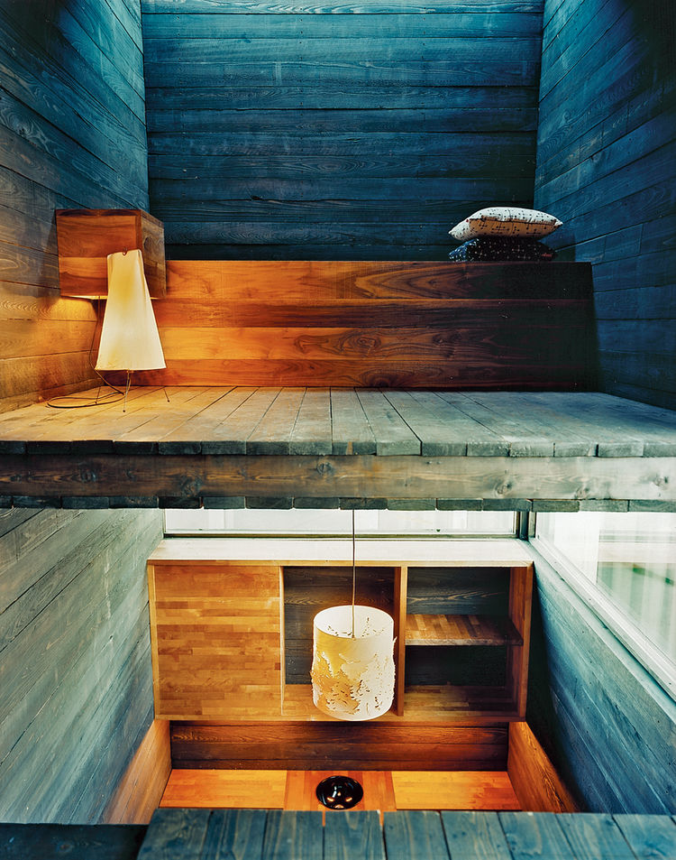 """From the sitting room you can see into the bedroom, with its strip of window in the ceiling. From the kitchen table you have a view of the bathroom and the lofted living space above. """"You can see the stairs from your bed,"""" Rintala says."""