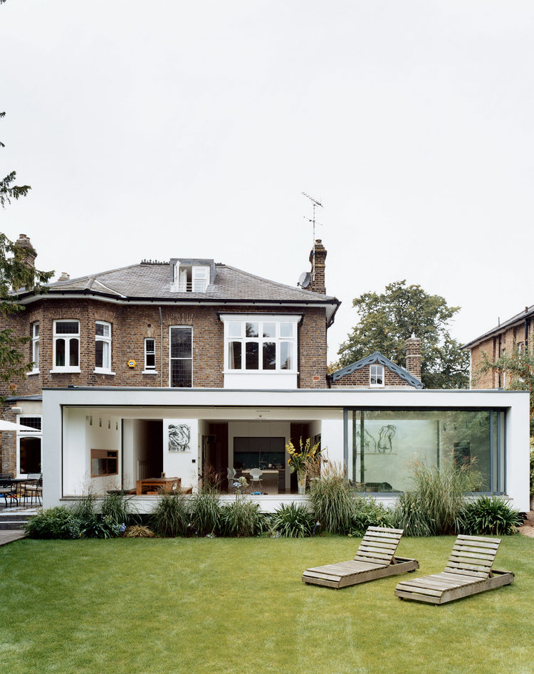 """New residential buildings are few and far between in England, so architects like Phillips have increasingly been charged with creating groundbreaking modern environments within the shells of historic houses. """"People just find it easier to work within exis"""
