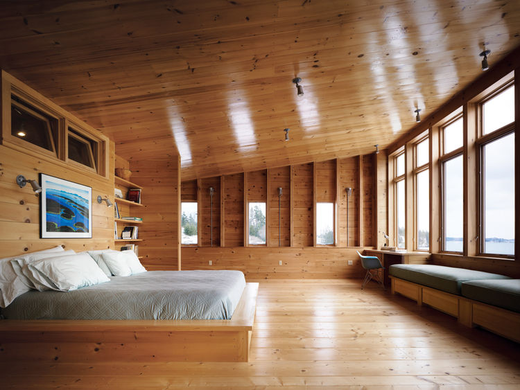 "The master bedroom opens up to the sea ""like a maw,"" says Callahan, who is delighted with the high ceilings and expansive space. Callahan and Hayes's full-time residence in Fairfield, Connecticut, is a 1734 farmhouse with, as she puts it, ""small, dark roo"