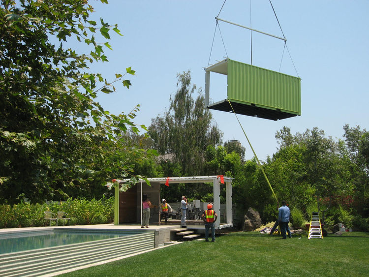 """Made up of two containers, the poolhouse, built by Eric Engheben of <a href=""""http://www.44west.net/"""">44 West Construction</a>, was placed on the prepped foundation in three hours."""