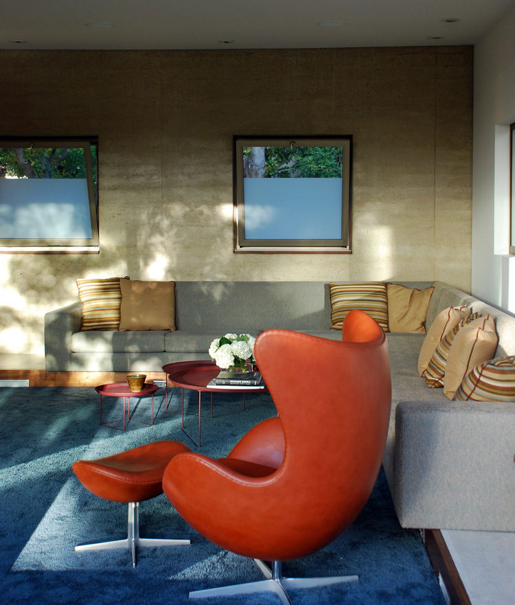 """The built-in sofa was designed by CCS Architecture and fabricated by San Francisco-based <a href=""""http://krollfurniture.com/"""">Kroll Furniture</a>. Barbara Vickroy, CCS's interior designer, picked the fabrics and furnishings in the home. In the foreground"""