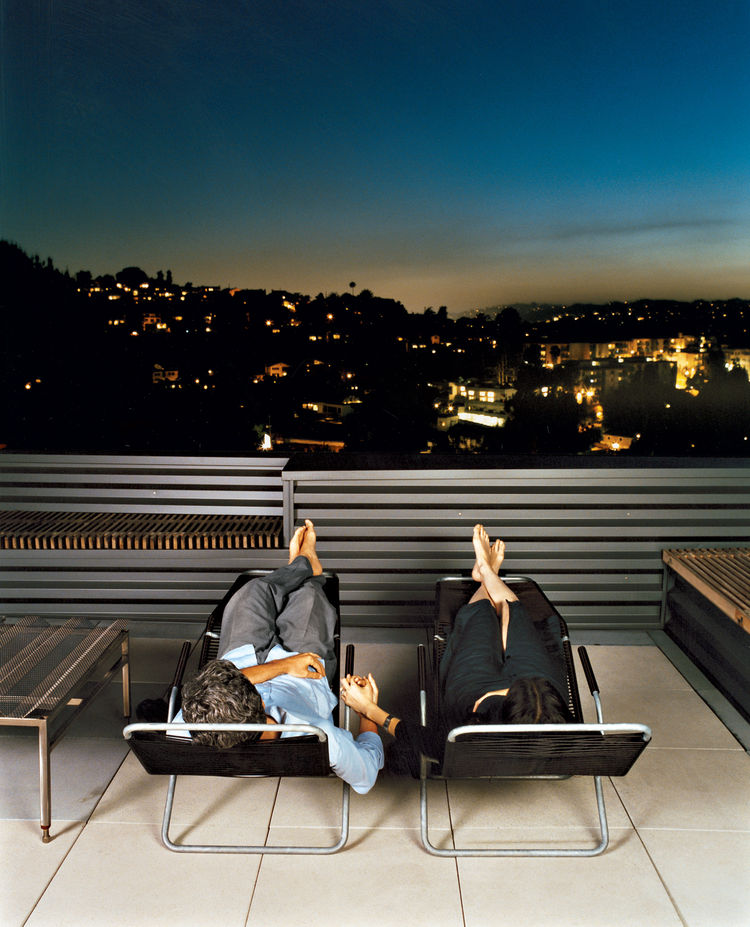 Joe Day and Nina Hachigian relax on their terrace overlooking the hills in Silver Lake area of Los Angeles.