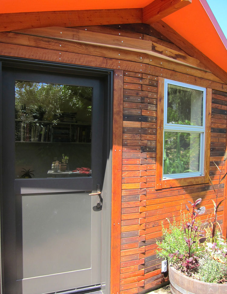 "Deeds used environmentally friendly wood stain and no-VOC paints for the exterior. ""These are not the cheapest finishes, but honestly way more pleasant to work with than the traditional smelly stuff,"" says Deeds. ""I'll have to report back on longevity and"