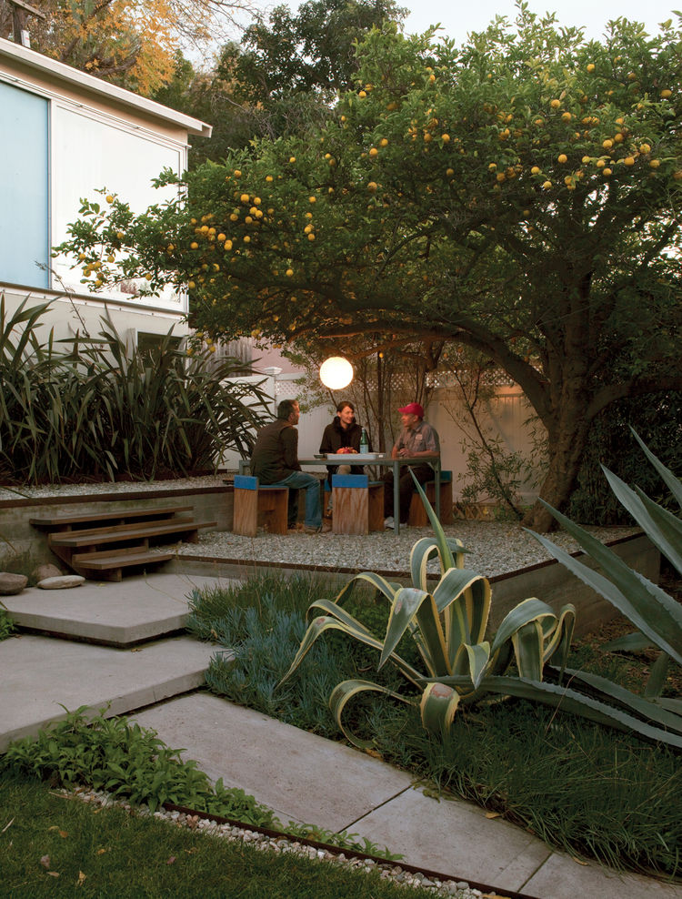Surrounded by flax, agaves, and a prolific lemon tree, the gravel terrace out front makes an inviting place to eat, work, or party. Molina and Turin fashioned the table from repurposed glass and Unistrut tube steel and the humble chairs from plywood wrapp