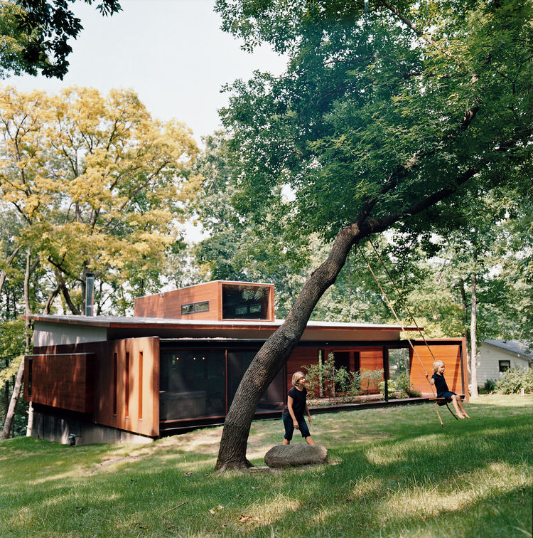 Maintaining a connection to their wooded backyard was an important consideration for the Edstorms. The back wall is designed to let in as much light and air as possible.