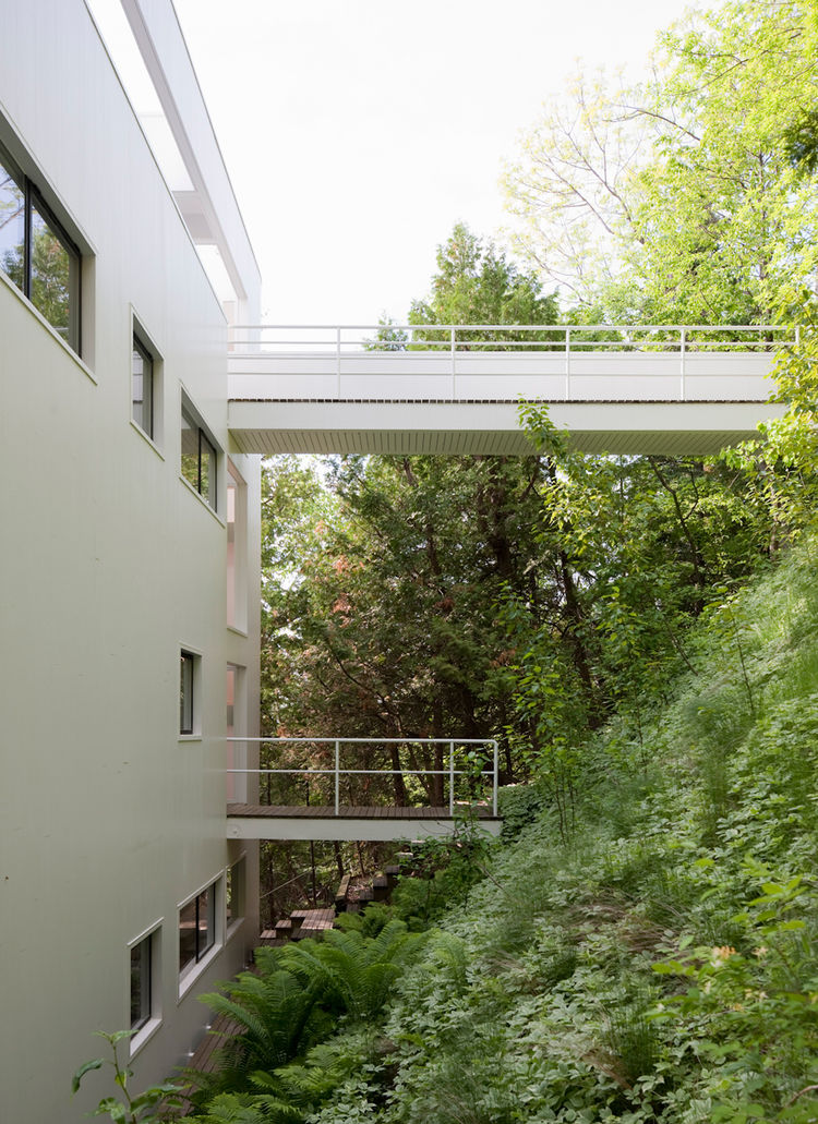 The upper and lower foot bridges connecting the Douglas House to the surrounding forest.