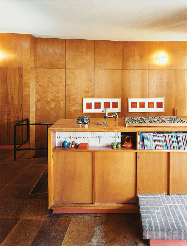 Tidy shelving provides perfect storage for Phaidon's Art and Ideas series. Joseph Albers prints hang in the background.