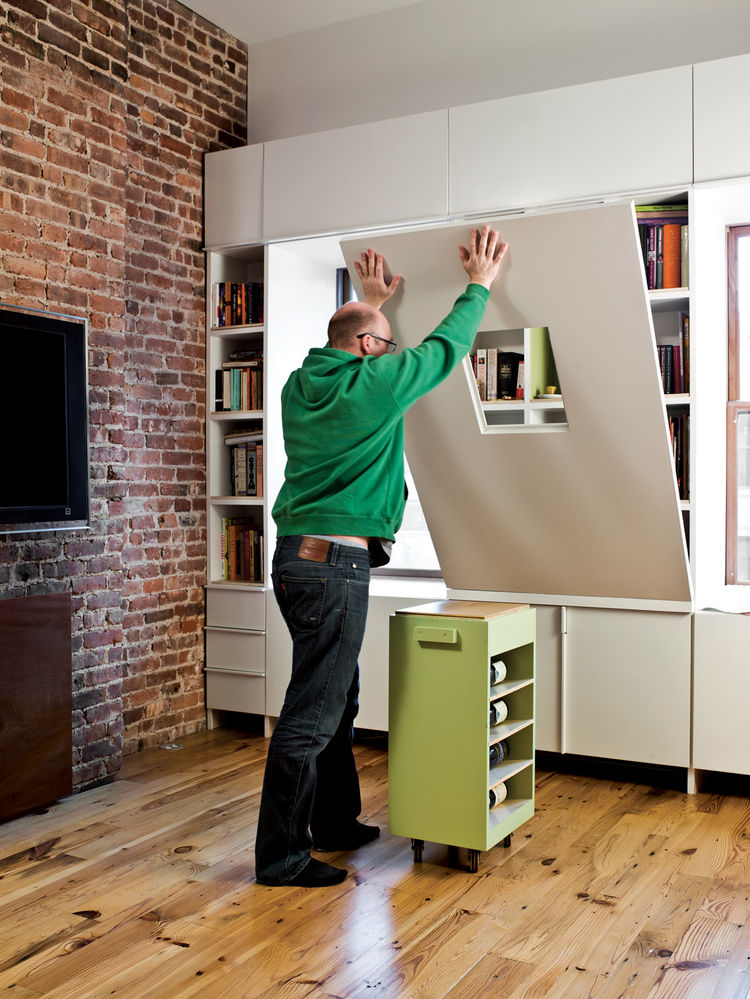 The table's base, which itself is an additional storage container, rolls easily into place to support the surface.