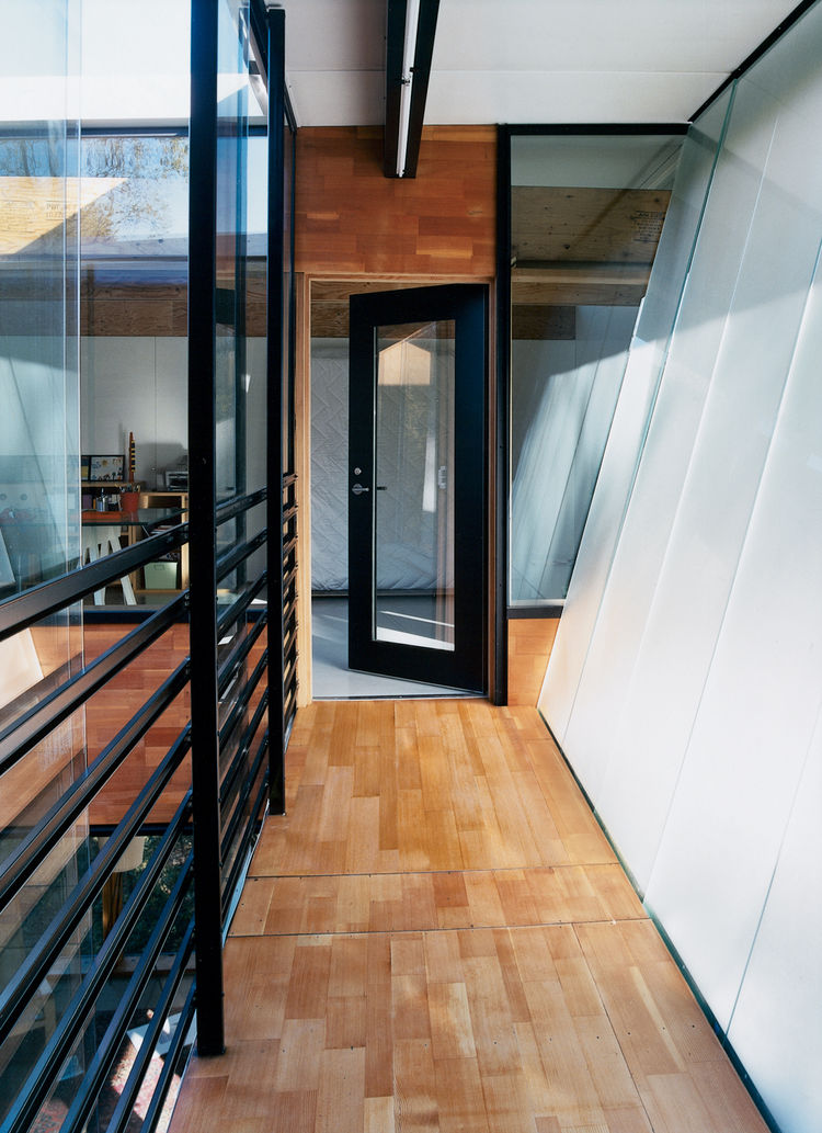 modular home with a glass fronted walkway