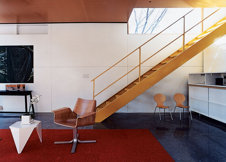 Modern living room designs with industrial stairs
