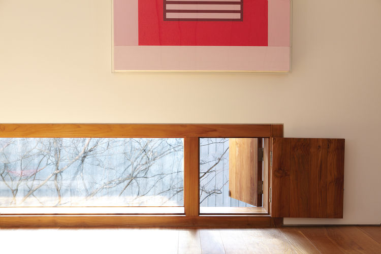 Strategically placed wooden windows like this one is an expression of Cho's style.