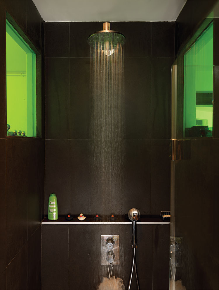 To create a sense of visual connection, Vinciguerra and Santiard set a colored window between the two rooms. They spent days making sure that the green transparency would meld nicely with the shade of green on the kitchen shelves.