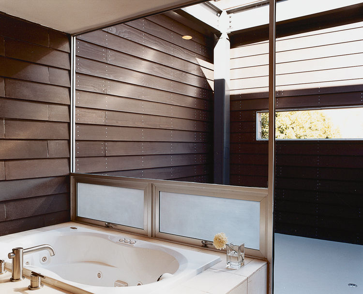 The master bathroom has its own open-air patio that faces the street.