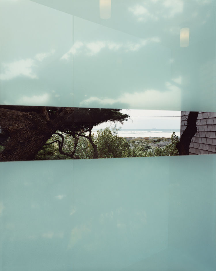 The frosted glass of the bridge offers a transparent stripe and a view of the ocean.