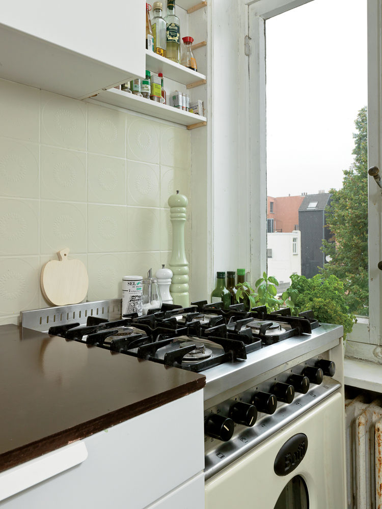 The kitchen offers a lovely view of neighborhood gardens.
