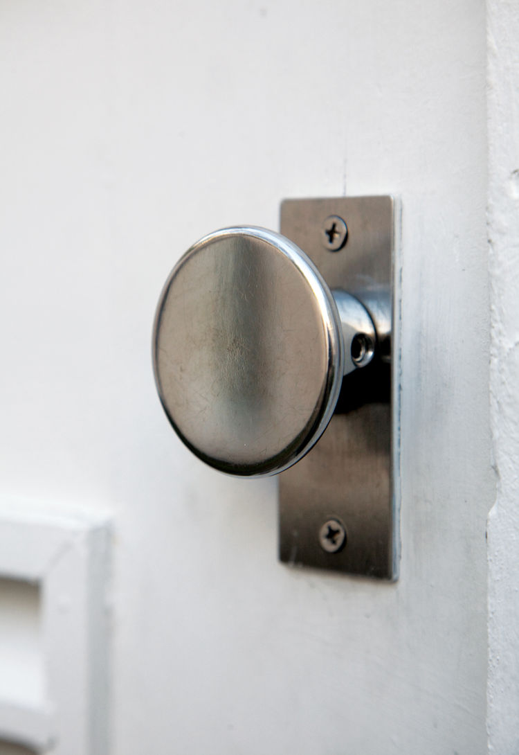 Isaacson designed the steel door handle and had it milled by local machinists in Lewiston.