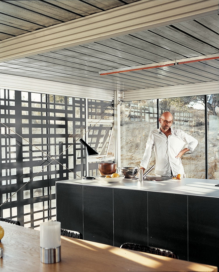 "All kitchen appliances, cupboards, and counters have been united in a single, self-contained island, designed in collaboration with Bulthaup. The architects wanted unfussy space and they rejected easy-access overhanging cabinets. ""There's an emphasis on c"