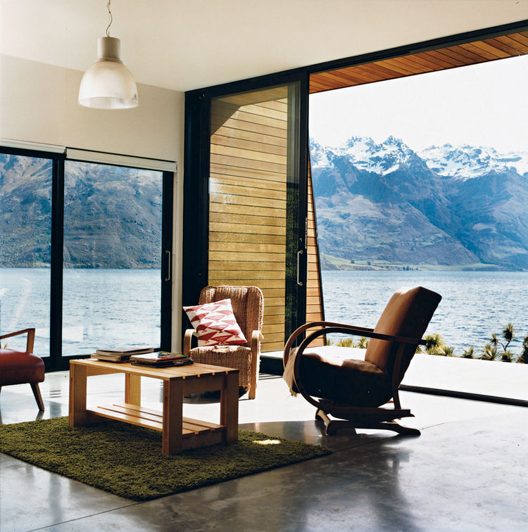 The main living area. The home is flanked on the east by a precipitous mountain range named The Remarkables. In summer, the weather gets hot enough for the family to go swimming and boating.