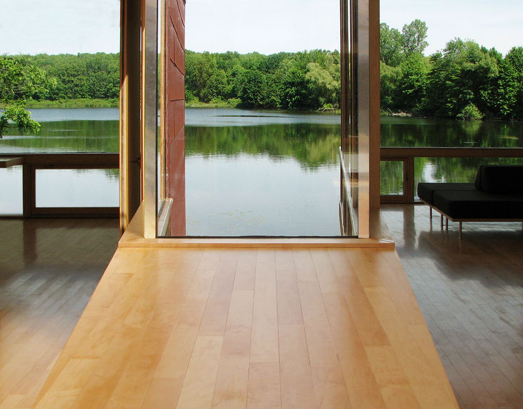 """""""Water visually fills the void between the two modules,"""" says Garrison, who designed the view sides of the building to jut out toward the lake."""