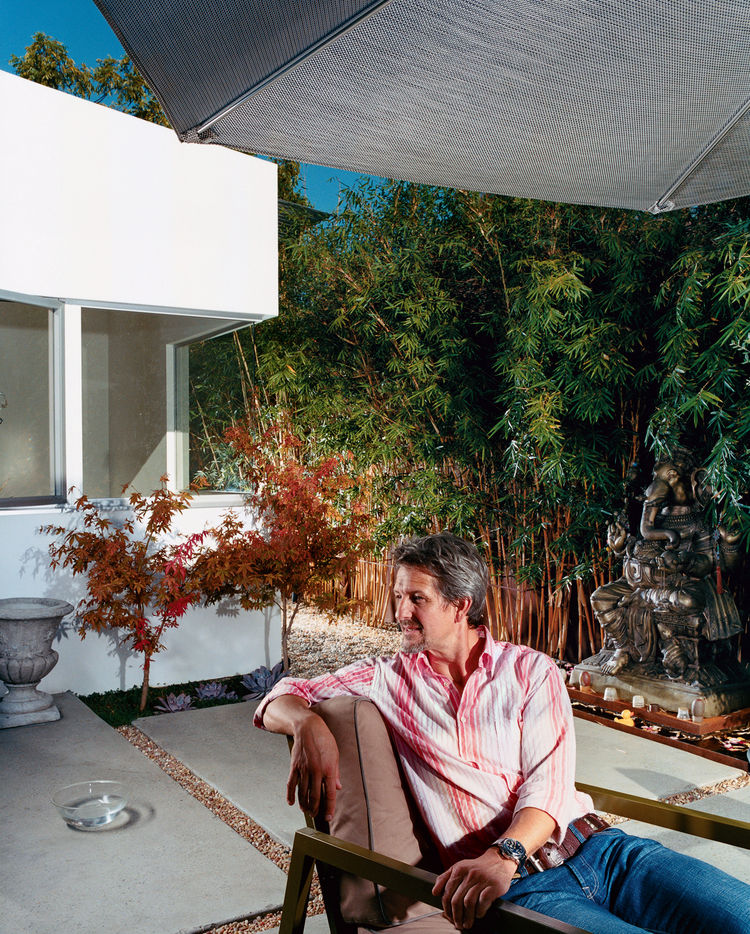 The front, middle, and rear yards are conceived as outdoor rooms. Pierre Kozely relaxes  in the middle yard in a prototype of an outdoor furniture line by Pietrarte. A bronze Ganesh is on a raised pedestal in the middle of a small water feature.