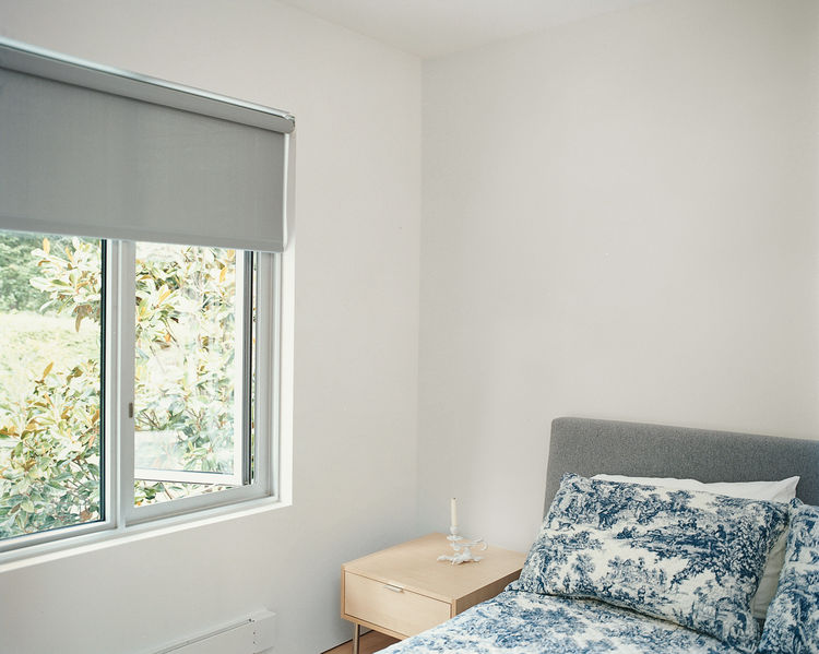 The guest room is furnished with pieces by neighbor and designer Niels Bendtsen.