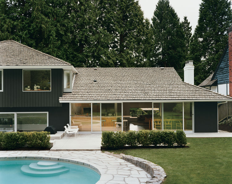 After trying dozens of colors, LeBlanc says, they settled on basic black for the exterior as  a way to best marry the building with its forest surroundings, which include 30-foot-high western red cedar trees. The pool is original; but the deck, once made