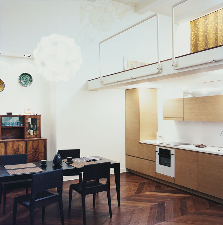 A mezzanine-level bedroom in Lithuania