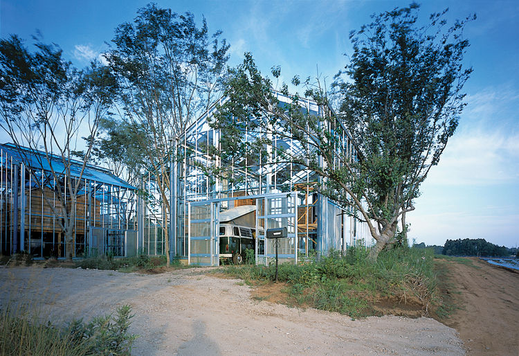 "Architect Hiroshi Iguchi's sustainable solution was to surround the greenhouses with tall, deciduous trees. In the summer, the ""breathing"" of the trees' leaves and the shadows they cast over the homes help cool the spaces. To combat moisture from the humi"