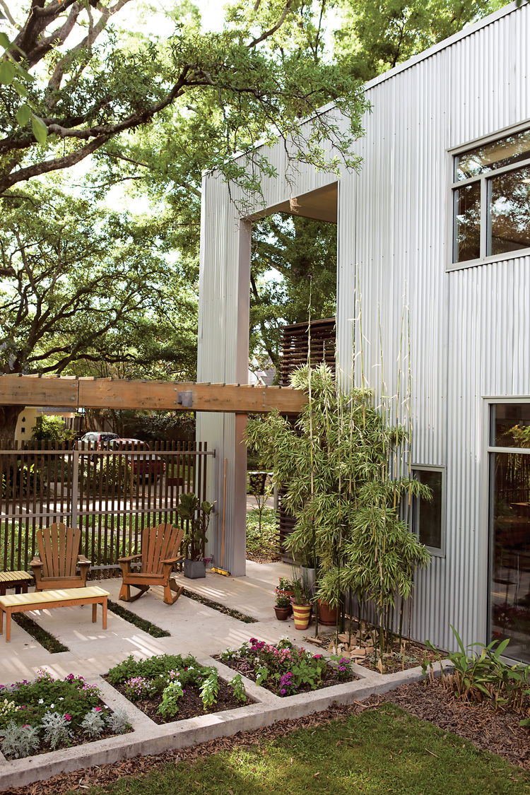 Though much of the outdoor life of the house is within the confines of the yard, the design has a porousness that allows a perpetual, if mediated, interaction with the neighbors and the street.